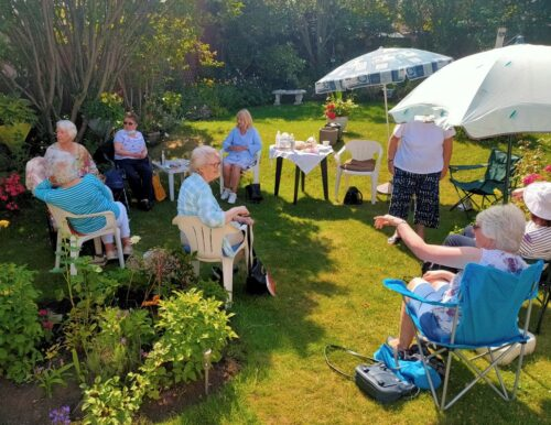 Book club social distancing in the garden in Seaham